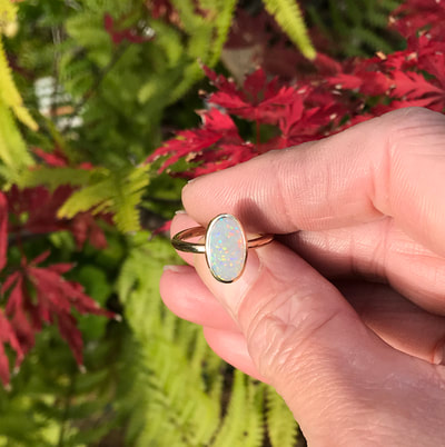 modern opal ring 9ct gold